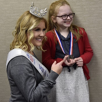 Hadley poses with Miss Idaho
